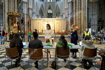 Catherine Duchess of Cambridge (centre) speaks to staff during a visit to the vaccination centre at Westminster Abbey, London, to pay tribute to the efforts of those involved in the Covid-19 vaccine rollout.