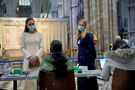 Catherine Duchess of Cambridge (left) speaks to staff during a visit to the vaccination centre at Westminster Abbey, London, to pay tribute to the efforts of those involved in the Covid-19 vaccine rollout.
