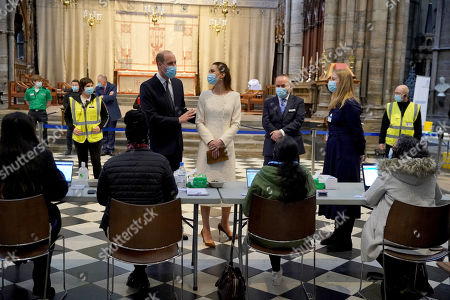 Prince William and Catherine Duchess of Cambridge speak to staff during a visit to the vaccination centre at Westminster Abbey, London, to pay tribute to the efforts of those involved in the Covid-19 vaccine rollout.