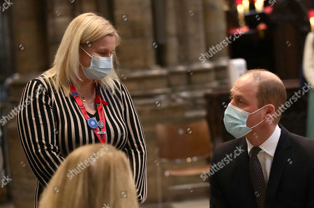 Prince William speaks to Pippa Nightingale, chief nurse at Chelsea and Westminster Hospital NHS Foundation Trust, during a visit to the vaccination centre at Westminster Abbey, London, to pay tribute to the efforts of those involved in the Covid-19 vaccine rollout.