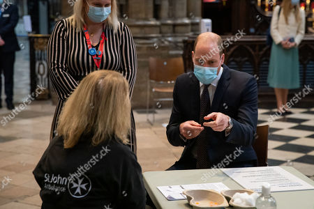 Editorial picture of Prince William and Catherine, Duchess of Cambridge visit to vaccination centre, London, UK - 23 Mar 2021
