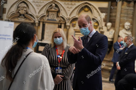 Editorial photo of Prince William and Catherine, Duchess of Cambridge visit to vaccination centre, London, UK - 23 Mar 2021