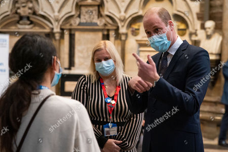 Prince William speaks to a member of staff with Pippa Nightingale (centre), chief nurse at Chelsea and Westminster Hospital NHS Foundation Trust, during a visit to the vaccination centre at Westminster Abbey, London, to pay tribute to the efforts of those involved in the Covid-19 vaccine rollout.