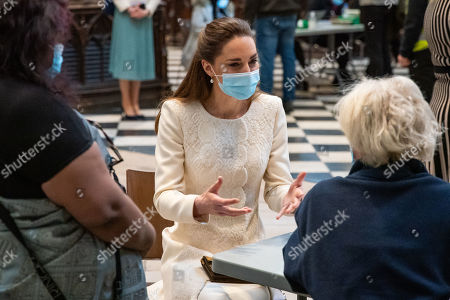 Catherine Duchess of Cambridge speaks to a member of the public during a visit to the vaccination centre at Westminster Abbey, London, to pay tribute to the efforts of those involved in the Covid-19 vaccine rollout.
