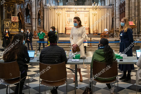 Stock Picture of Catherine Duchess of Cambridge speaks to members of staff during a visit to the vaccination centre at Westminster Abbey, London, to pay tribute to the efforts of those involved in the Covid-19 vaccine rollout.