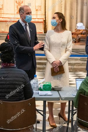 Stock Image of Prince William and Catherine Duchess of Cambridge speak to members of staff during a visit to the vaccination centre at Westminster Abbey, London, to pay tribute to the efforts of those involved in the Covid-19 vaccine rollout.