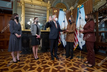 United States Vice President Kamala Harris  (R) ceremonially swears in Ambassador William Burns (C) as Director of the Central Intelligence Agency in the Eisenhower Executive Office Building in Washington, DC, USA, 23 March 2021. Burn's wife Lisa Carty (2-R) holds the Bible as daughters Elizabeth and Sarah Burns look on.