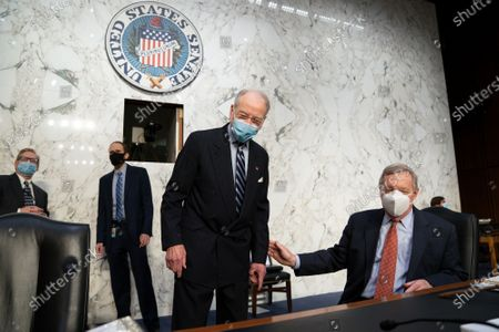 Stock Image of Sen. Chuck Grassley, R-Iowa, the ranking member, left, and Sen. Dick Durbin, D-Ill., chairman of the Senate Judiciary Committee, confer as their panel examines constitutional and common sense steps to reduce gun violence, at the Capitol in Washington