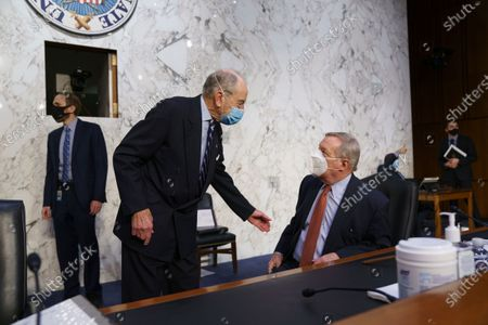 Sen. Chuck Grassley, R-Iowa, the ranking member, left, and Sen. Dick Durbin, D-Ill., chairman of the Senate Judiciary Committee, confer as their panel examines constitutional and common sense steps to reduce gun violence, at the Capitol in Washington
