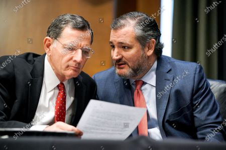 Sens. John Barrasso (R-Wyo.) speaks to Sen. Ted Cruz (R-Texas) as Samantha Power, nominee to be Administrator of the United States Agency for International Development, answers questions during her Senate Foreign Relations Committee confirmation hearing in Washington, DC, USA, 23 March 2021.