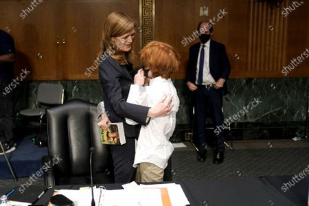 Samantha Power, nominee to be Administrator of the United States Agency for International Development, embraces her children Rian and Declan Power Sunstein along with her husband Cass Sunstein after her Senate Foreign Relations Committee confirmation hearing in Washington, DC, USA, 23 March 2021.