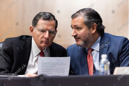 Sen. Ted Cruz, R-Texas, talks with Sen. John Barrasso, R-Wyo., during a Senate Foreign Relations Committee hearing on the nomination of Samantha Power to be the next Administrator of the United States Agency for International Development (USAID), on Capitol Hill in Washington