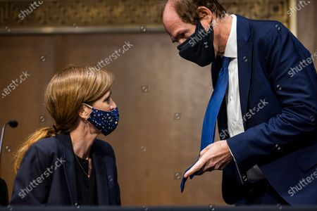 Former U.S. Ambassador to the United Nations, Samantha Power, chats with her husband, Cass Sunstein, right, before testifying before the Senate Foreign Relations Committee to be the next Administrator of the United States Agency for International Development (USAID), on Capitol Hill in Washington