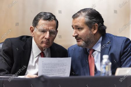 Sen. Ted Cruz, D-TX, speaks with Sen. John Barrasso, R-WY, as they question Samantha Power, nominee to be Administrator of the United States Agency for International Development, during her confirmation hearing before the Senate Foreign Relations Committee Tuesday, March 23, 2021.