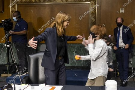 Samantha Power, nominee to be Administrator of the United States Agency for International Development, embraces her children Rían and Declan Power Sunstein along with her husband Cass Sunstein at the end of her confirmation hearing before the Senate Foreign Relations Committee in Washington, DC on Tuesday, March 23, 2021.