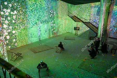 """Stock Picture of The Immersive Experience is a one-of-a-kind digital art exhibition. The main masterpieces of Gustav Klimt as well as the key stages of his career literally come alive to give you a 360° immersive experienceThe exhibition is visible by group and with a guide from Sophie Legrand's """"Itineraries"""" company"""