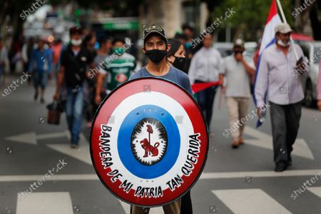 Ciudad del Este residents have traveled to the Paraguayan capital calling for the resignation of President Mario Abdo Benitez over his handling of the new coronavirus pandemic and the state of the public health system, in Asuncion, Paraguay