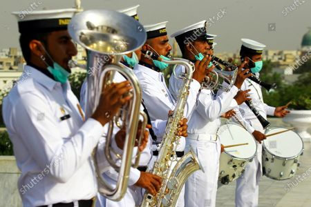 Pakistani Navy Band members perform during a ceremony to mark the Pakistan Day at the mausoleum of the country's founder Muhammad Ali Jinnah in southern Pakistani port city of Karachi on March 23, 2021. Pakistan Day, also known as Republic Day, falls on March 23 annually.