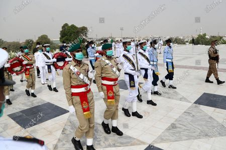 Soldiers take part in a ceremony to mark the Pakistan Day at the mausoleum of the country's founder Muhammad Ali Jinnah in southern Pakistani port city of Karachi on March 23, 2021. Pakistan Day, also known as Republic Day, falls on March 23 annually.