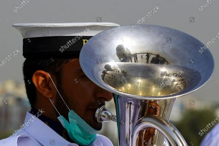 A Pakistani Navy Band member performs during a ceremony to mark the Pakistan Day at the mausoleum of the country's founder Muhammad Ali Jinnah in southern Pakistani port city of Karachi on March 23, 2021. Pakistan Day, also known as Republic Day, falls on March 23 annually.