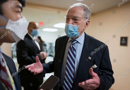 Sen. Chuck Grassley, R-Iowa, the ranking member of the Senate Judiciary Committee, pauses for reporters as senators head to the chamber for a procedural vote on the nomination of Shalanda Young to be deputy director of the Office of Management and Budget, at the Capitol in Washington