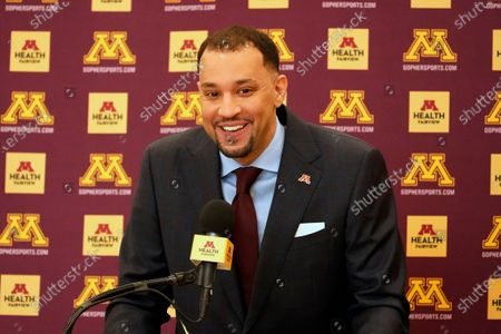 New University of Minnesota mens' head basketball coach Ben Johnson addresses the media after he was introduced, in Minneapolis. Johnson replaces Richard Pitino, who was fired after eight seasons and took the job at New Mexico