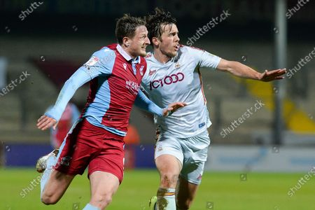 Scunthorpe United Ryan Loft (9) Bradford City Niall Canavan (5) battles for possession during the EFL Sky Bet League 2 match between Scunthorpe United and Bradford City at the Sands Venue Stadium, Scunthorpe