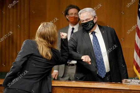 Senate Foreign Relations Committee Chairman Robert Menendez (D-N.J.) elbow bumps Samantha Power, nominee to be Administrator of the United States Agency for International Development, as she arrives for her confirmation hearing before the Senate Foreign Relations Committee.