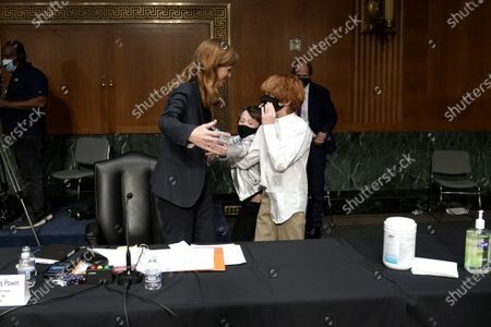 Stock Image of Samantha Power, nominee to be Administrator of the United States Agency for International Development, embraces her children Rían and Declan Power Sunstein along with her husband Cass Sunstein after her Senate Foreign Relations Committee confirmation hearing.
