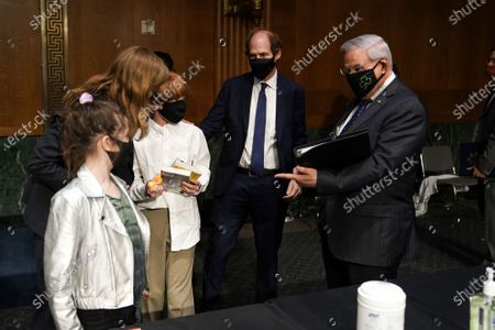 Samantha Power, nominee to be Administrator of the United States Agency for International Development, reintroduces her children Rían and Declan Power Sunstein to Senate Foreign Relations Committee Chairman Robert Menendez (D-N.J.) after her confirmation hearing.