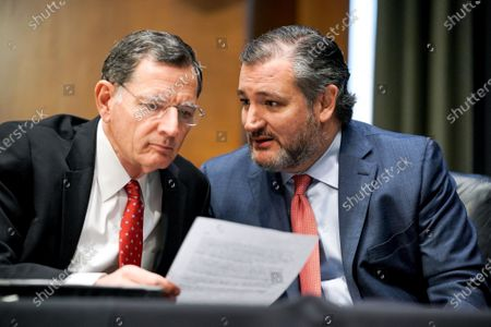 Sens. John Barrasso (R-Wyo.) speaks to Sen. Ted Cruz (R-Texas) as Samantha Power, nominee to be Administrator of the United States Agency for International Development, answers questions during her Senate Foreign Relations Committee confirmation hearing.