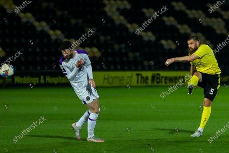 Michael Bostwick of Burton Albion shoots