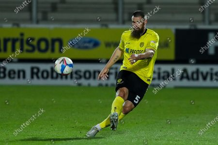 Michael Bostwick of Burton Albion angles a pass forward