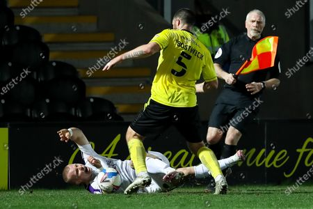 Curtis Main of Shrewsbury Town is fouled by Michael Bostwick of Burton Albion