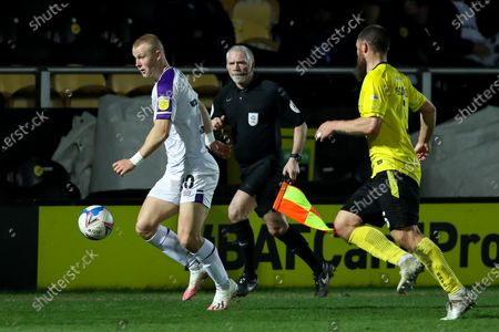 Curtis Main of Shrewsbury Town controls the ball, closed down by Michael Bostwick of Burton Albion