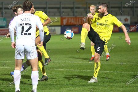 Michael Bostwick of Burton Albion (5) has a shot at goal during the EFL Sky Bet League 1 match between Burton Albion and Shrewsbury Town at the Pirelli Stadium, Burton upon Trent