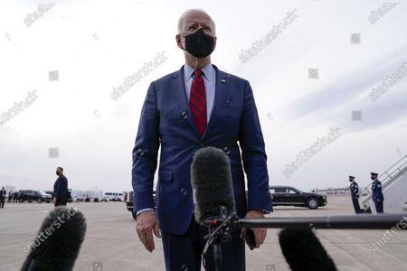 President Joe Biden talks to members of the press before boarding Air Force One on departure from John Glenn Columbus International Airport, in Columbus, Ohio