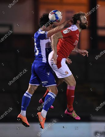 Stock Photo of George Williams of Bristol Rovers contends for the aerial ball with Brett Pitman of Swindon Town