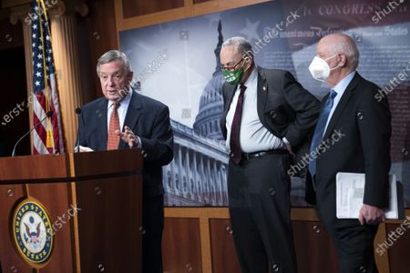 Sen. Richard Durbin, D-IL, speaks alongside Senate Majority Leader Charles Schumer, D-NY, and Sen. Ben Cardin, D-MD, during a press conference following the Senate policy luncheon on Capitol Hill in Washington, DC on Tuesday, March 23, 2021.