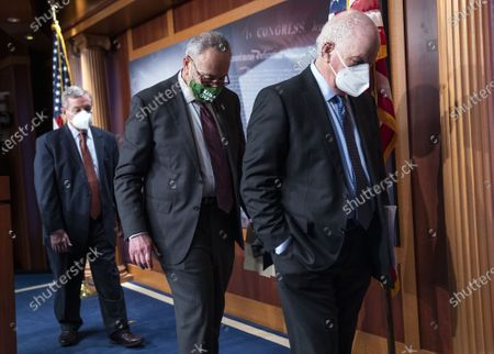 Senate Majority Leader Chuck Schumer, D-N.Y., joined by Sen. Richard Durbin, D-Ill., and Sen. Ben Cardin, D-Md., depart after a news conference following the Senate policy luncheon on Capitol Hill in Washington
