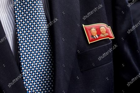A badge worn by Kim Yu-song, North Korean counsellor depicting former leaders Kim Il Sung and Kim Jong Il seen outside the embassy in Kuala Lumpur. North Korean staff left the country's embassy in Bukit Damansara, Malaysia after Pyongyang cut diplomatic ties with Kuala Lumpur for extraditing a DPRK national to the U.S.