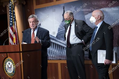 United States Senate Majority Whip Dick Durbin (Democrat of Illinois), speaks alongside US Senate Majority Leader Chuck Schumer (Democrat of New York), and US Senator Ben Cardin (Democrat of Maryland), during a press conference following the Senate policy luncheon on Capitol Hill in Washington, DC.
