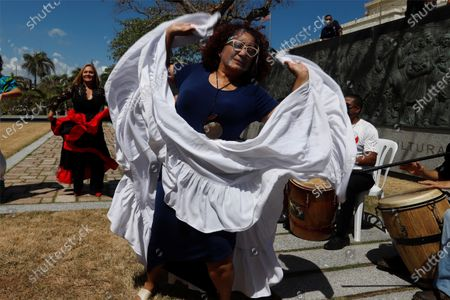 The founder and executive director of the Escuela de Bomba y Plena Dona Caridad Brenes, Tata Cepeda, dances Bomba during the celebration of National Bomba Day in the Plaza de la Identidad Puertorriquena, on the south side of the Capitol (headquarters of the legislative chambers) in the capital San Juan, Puerto Rico, 23 March 2021. Puerto Rico commemorates National Pump Day, a musical genre that was born on the island with the arrival of African slaves centuries ago and is reborn with more and more women.