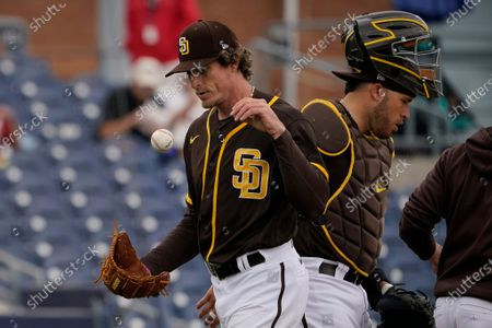 San Diego Padres pitcher Tim Hill walks off the mound after being taken out of a spring training baseball game against the Cincinnati Reds in the sixth inning, in Peoria, Ariz