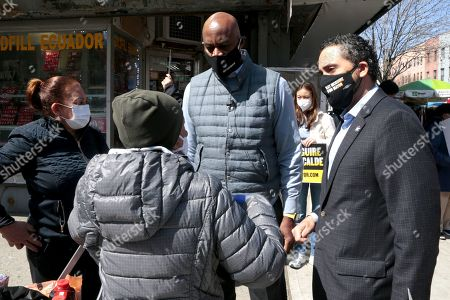 Stock Image of Mayoral Candidate Ray McGuire receives the endorsement of New York Assembly Member Robert Rodriguez while canvassing the East Harlem section of New York City