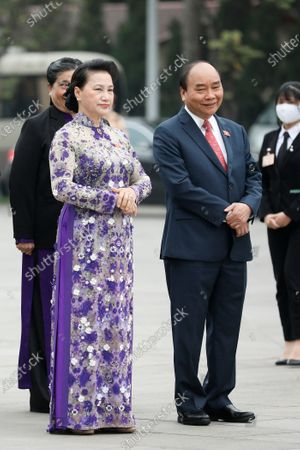 Vietnam's Prime Minister Nguyen Xuan Phuc (R) and Chairwoman of the National Assembly Nguyen Thi Kim Ngan (L) attend a wreath laying ceremony ahead of the 11th session of the National Assembly's 14th tenure in Hanoi, Vietnam 24 March 2021. The 14th National Assembly, which takes place in Hanoi from 24 March to 07 April 2021, will focus on voting for new leadership positions.