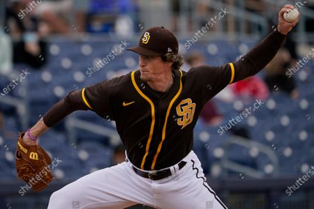 San Diego Padres' Tim Hill pitches during a spring training baseball game against the Cincinnati Reds, in Peoria, Ariz