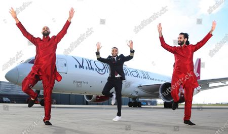 Stock Photo of Aston Merrygold surprised dance duo Bounce Bhangra with the news that they are the first winners of Virgin Atlantic's Airplause initiative. Mrinal and Vikram Seth, aka Bounce Bhangra, became a viral sensation when they kept the nation moving after moving their popular Bounce Bhangra classes online. Virgin Atlantic is calling on the nation to choose the next Airplause winner by nominating someone who made them smile during lockdown to win prize flights to top destinations such as the Caribbean, India, Israel or the USA