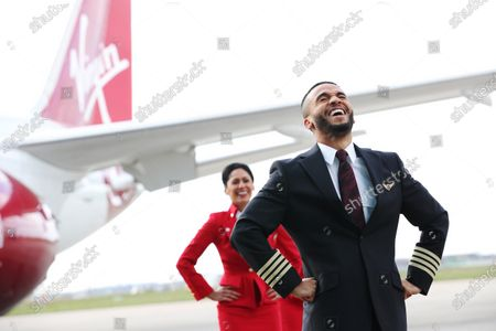 Stock Picture of Aston Merrygold surprised dance duo Bounce Bhangra with the news that they are the first winners of Virgin Atlantic's Airplause initiative. Mrinal and Vikram Seth, aka Bounce Bhangra, became a viral sensation when they kept the nation moving after moving their popular Bounce Bhangra classes online. Virgin Atlantic is calling on the nation to choose the next Airplause winner by nominating someone who made them smile during lockdown to win prize flights to top destinations such as the Caribbean, India, Israel or the USA