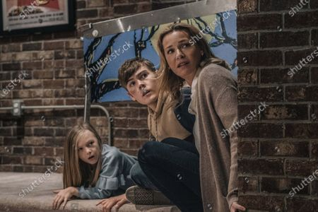 Stock Photo of Paisley Cadorath, Gage Munroe, Connie Nielsen